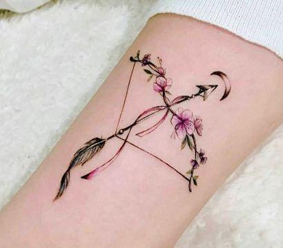 Татуировка лук и стрелы: виды и значение